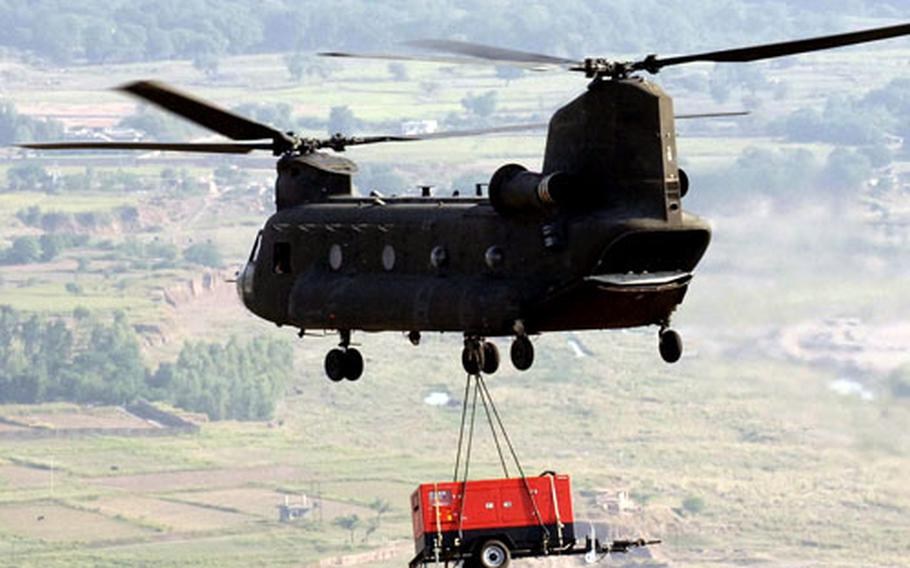 Chinooks assigned to Task Force Storm were involved in a lot of battles during their yearlong stint in southern Afghanistan. But they also performed other roles, such as providing humanitarian assistance to earthquake victims in Pakistan as shown in this picture.
