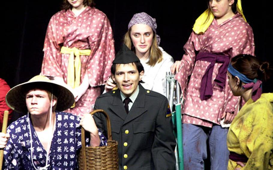 """How do you put on a play about a village with just 13 students? Most cast members in """"Teahouse of the August Moon"""" play several characters, then do all the set changes between acts. Front row, from left, are Austin Strickland, Troy Zapata and Tara Turpin. In the back row are, from left, Margret Lampe, Raechel Inbody and Ashley Deane."""