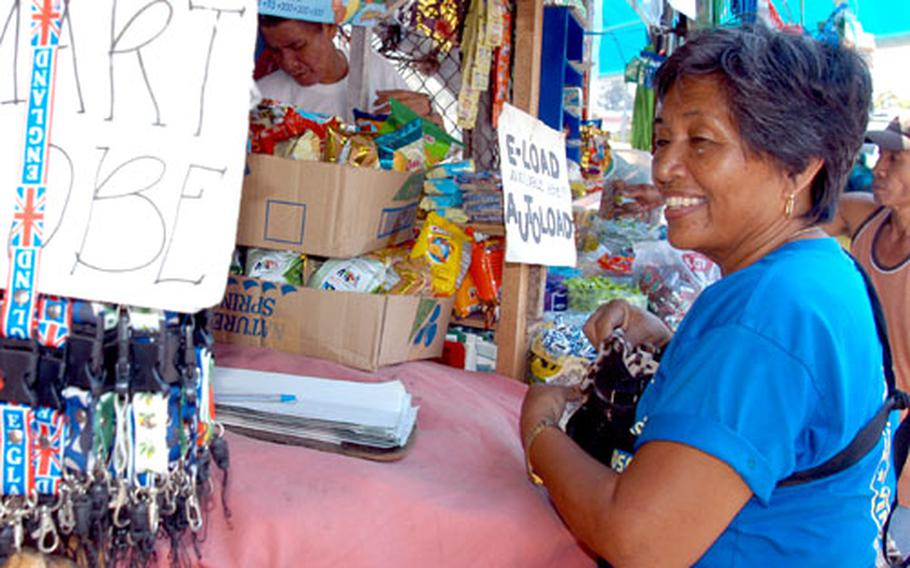 """Lolita Espinosa is a street vendor right outside Subic Bay Freeport. She, like other residents in the city, questions whether a rape occurred and said she supports """"Americans,"""" who pump money into the economy when they train at the former Subic Naval Base."""