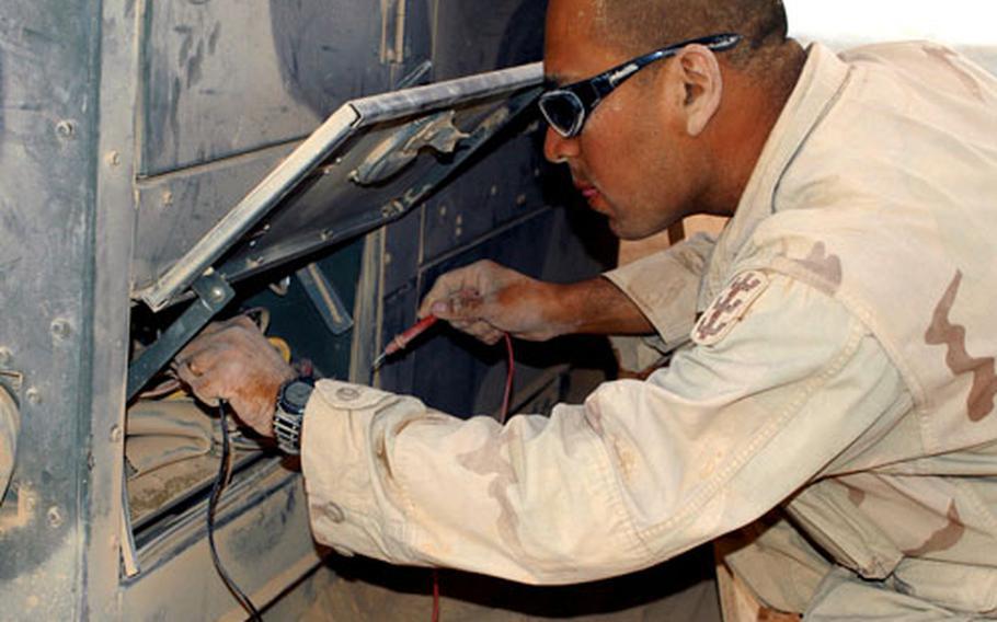 Spc. Hugo Romero, Headquarters Support Company, 94th Engineer Combat Battalion (Heavy), worked last August in Rawah, Iraq.