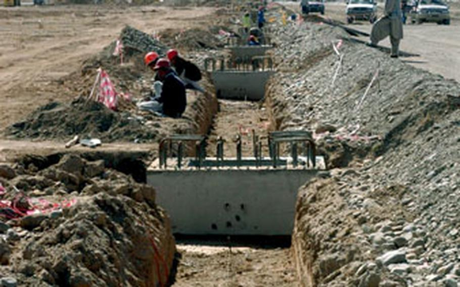 A massive effort is under way to lengthen and widen the runway at Kandahar Airfield to allow more varied uses of the largest coalition base in southern Afghanistan.