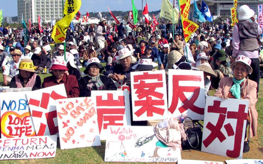 A group of women from the northeast Okinawa fishing village of Henoko were among the thousands of people attending Sunday's rally in Ginowan.