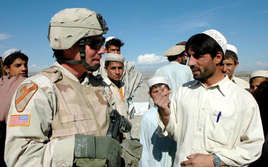 Capt. Jeffrey Hembree talks to workers at an irrigation work site in Afghanistan's southern Khowst province.