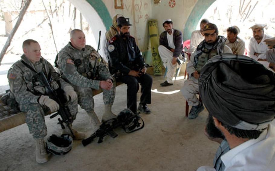 Capt. Bradford Garrison, second from left, meets with locals in Khowst province.