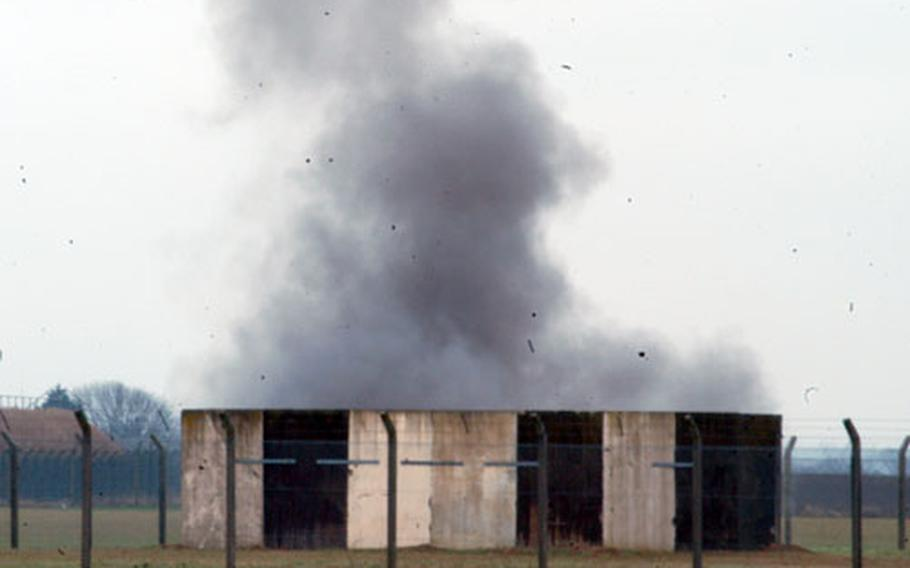 Smoke bellows out of an explosion chamber during a 48th Civil Engineer Squadron's Explosive Ordnance Disposal Flight exercise.