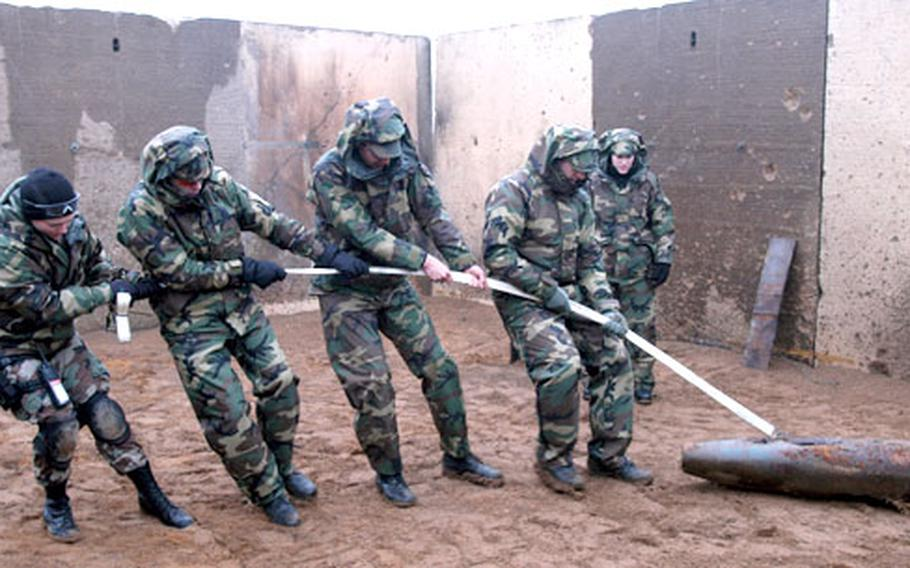 Members of the unit pull a shell filled with concrete during a recent exercise.