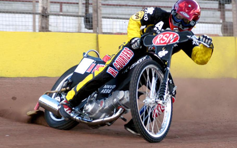 Jon Armstrong, a member of the Fen Tigers racing team, skids his 500cc racing bike around a corner during a practice run at the Mildenhall Speedway track.