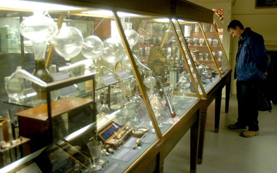 A visitor to Oxford's History of Science Museum admires chemistry-related items on display.