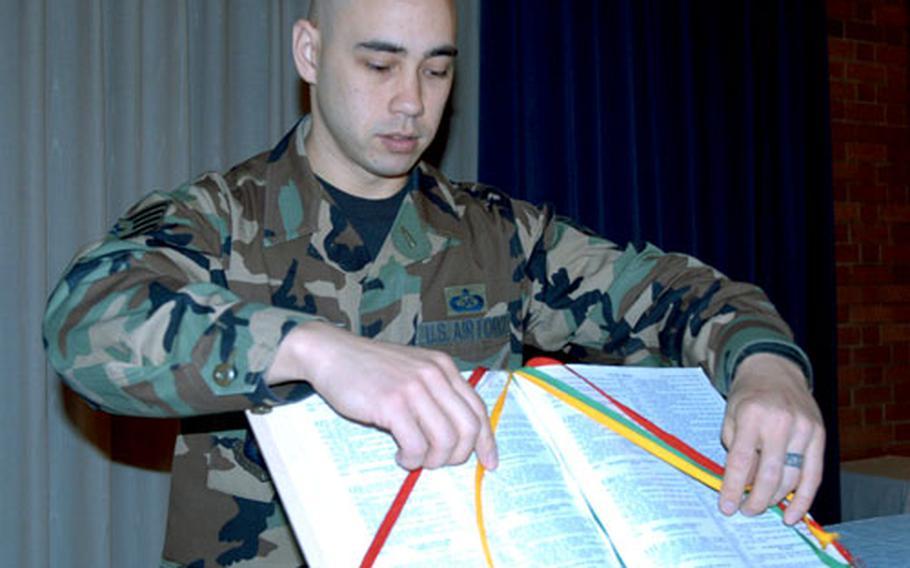 Sgt. Michael C. Chin prepares a Bible at the base chapel at RAF Lakenheath.