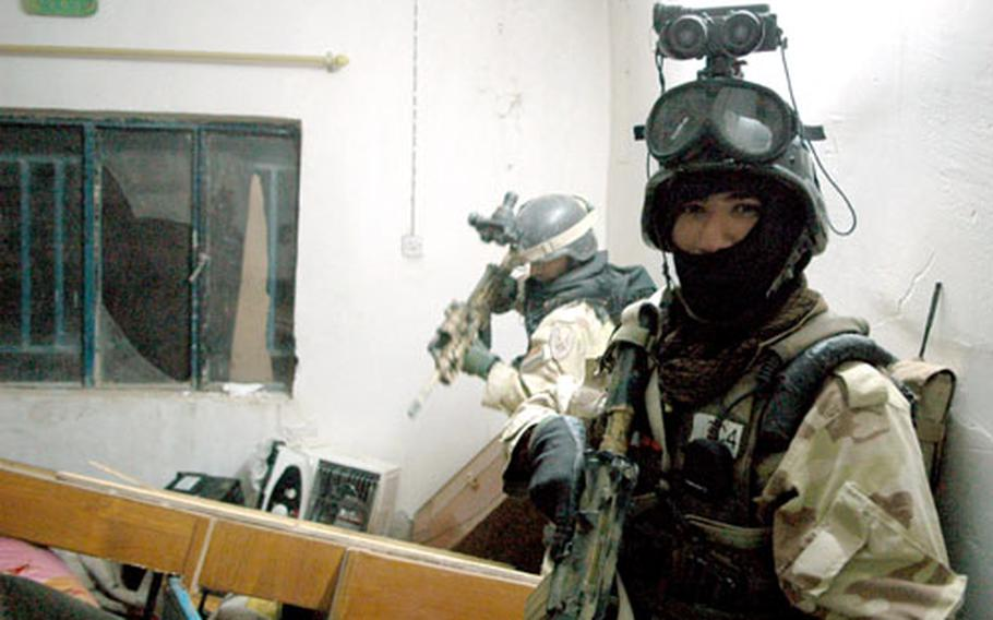 Iraqi Counter Terrorism Force soldiers search the home where a hostage was discovered Monday east of Taji.
