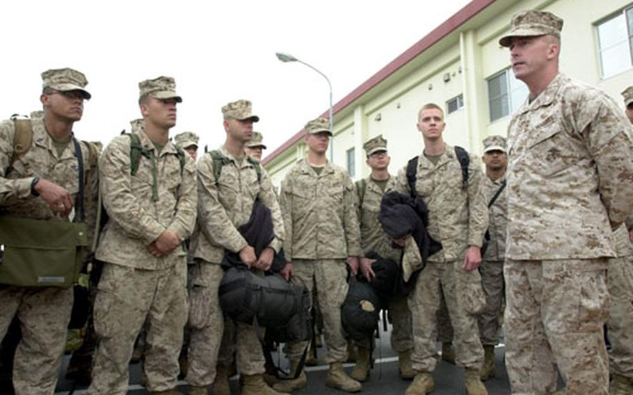 Lt. Col. Jamie Gannon, right, commanding officer of Combined Medical Relief Team 3, talks to Marines and sailors of the team after their arrival at Camp Hansen on Tuesday.