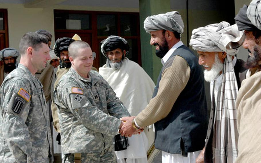 Lt. Col. Joe Fenty, commander of the 3rd Battalion, 71st Cavalry Squadron, left, and B Troop commander Capt. Frank Brooks, speak with Tani district sub-governor Badi Zaman and local elders at the district compound. The battalion will conduct reconnaissance operations with special attention to the Pakistan-Afghanistan border.