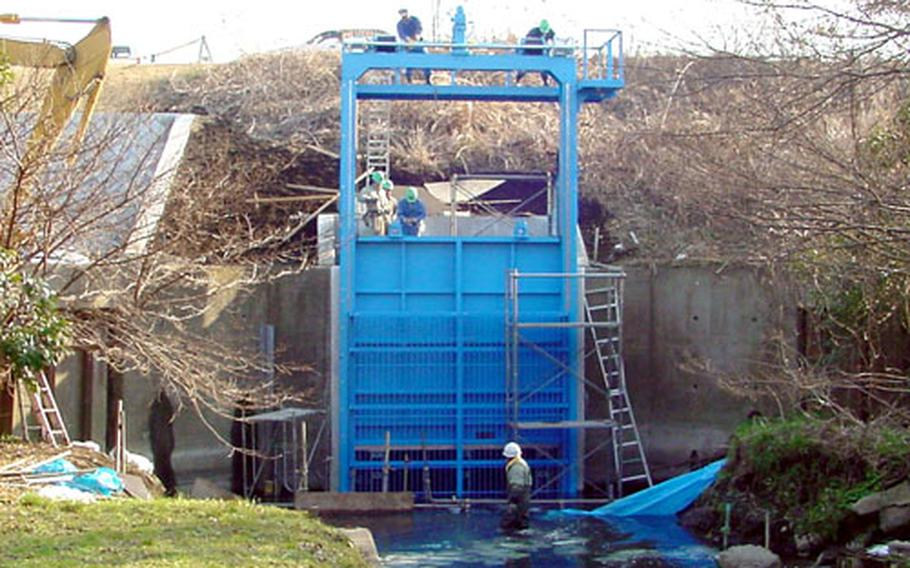 A spill gate at Naval Air Facility Atsugi, Japan, was installed last month to prevent contaminated water from reaching Japanese land should a spill occur.