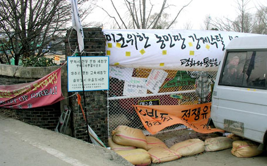 The school's barricaded gate is just yards from the Camp Humphreys perimeter.