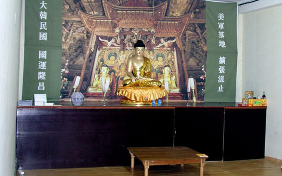 Inside the school, a room is set up as a Buddhist place of worship. Residents of the surrounding Daechu-ri farming village are using the room while barricaded inside the compound.