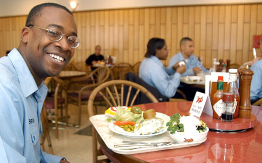 Petty Officer First Class Cliff Brown prepares to dine at the Commodore Matthew C. Perry General Mess (The Jewel of the East) on Wednesday. The Yokosuka Naval Base galley won first place for overseas service for the second year running.