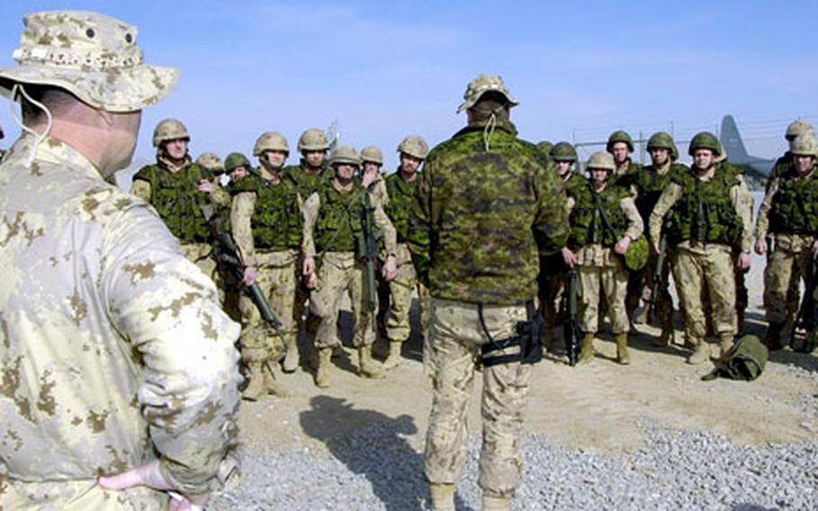 Canadian troops receive a briefing on the flightline after arriving at Kandahar Airfield, Afghanistan, in January. Canadians now head Multinational Task Force Aegis, which has responsibility for southern Afghanistan.