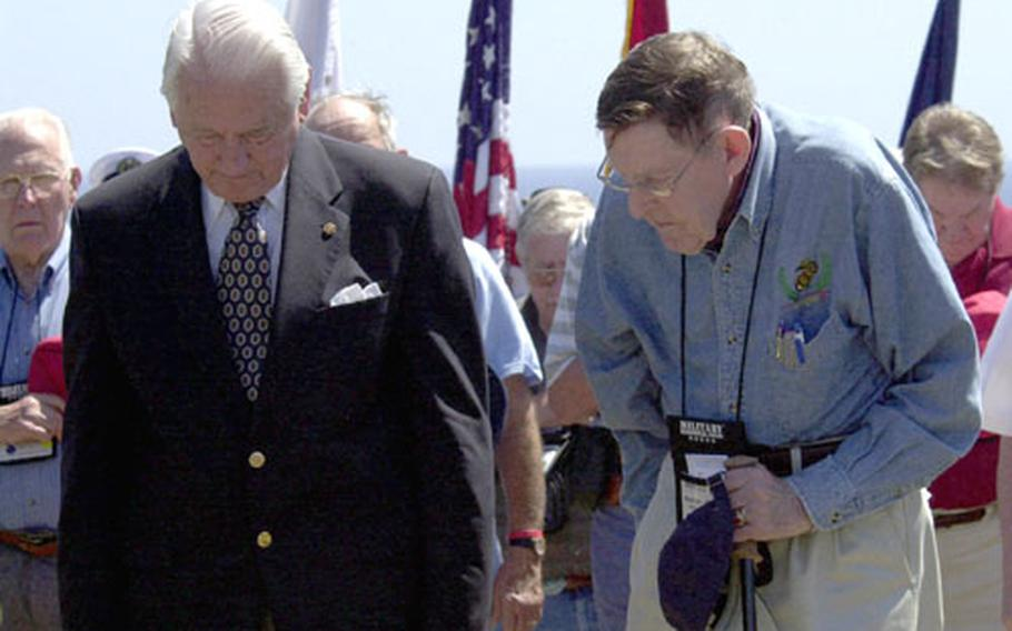 Retired U.S. Marine Corps generals Lt. Gen. Larry Snowden, left, and Maj. Gen. Fred Haynes pause for a moment of silence with other veterans of the battle of Iwo Jima during a 61st anniversary commemoration ceremony on Wednesday.