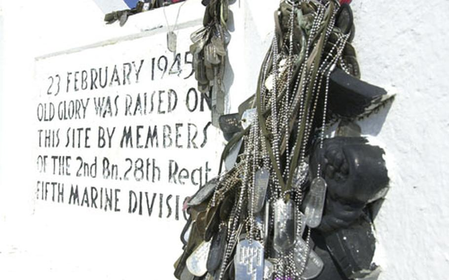 The monument paying tribute to the Mount Suribachi, Iwo Jima, flag raising in 1945 is adorned with dog tags of U.S. servicemembers who visited the site.