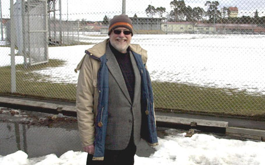 Steve Vojtecky, DODDS liaison officer for Grafenwöhr and Vilseck, Germany, stands at the softball field where a temporary middle school will be built in Grafenwöhr.