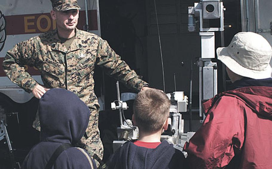 Gunnery Sgt. Justin Martone explains the functions of EOD at a 2004 Festival of Freedom and Air Show at the Manassas Regional Airport, Va. Martone was killed March 7 in Iraq.