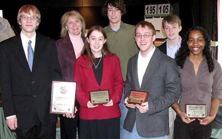 Heidelberg's team shows off its hardware Friday after completing an unbeaten run through the two-day DODDS-Europe Academic Games in Hambachtal, Germany. From left are team manager Jeff Enderton, team coach Karen Primmer, team captain Megan Bryan and team members Phil Cotter, Adam Lawrence, Randall Bryan and Kailan Sierra-Davidson.