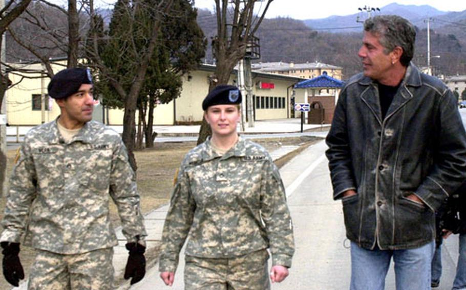 """Sgt. Luciano Vera, left and Pfc. Amanda Merfeld talk with chef and best-selling author Anthony Bourdain while filming for the television show, """"Anthony Bourdain: No Reservations."""" The show will air on the Travel Channel in the U.S. in June, and later on Discovery Channel Asia."""