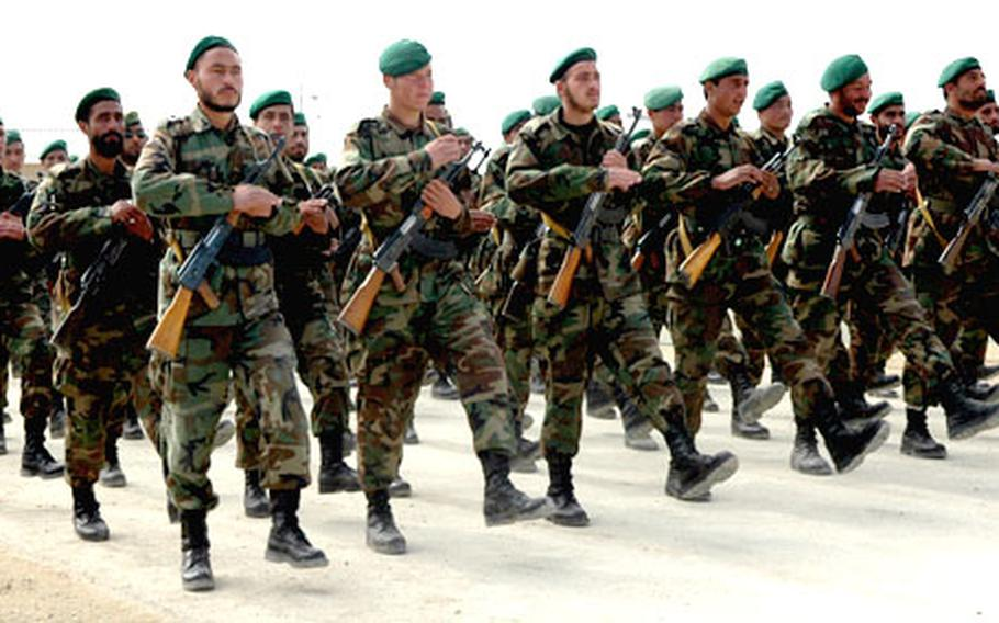 Afghan soldiers from the 203rd Corps march at Camp Thunder in preparation for a parade in Kabul. American military trainers are working with Afghan soldiers to develop the growing Afghan National Army.