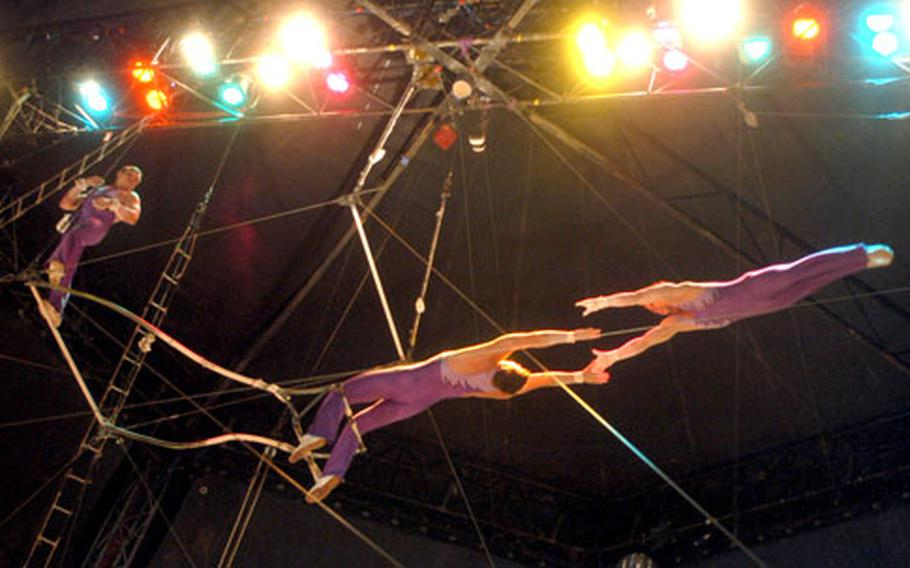 A Moscow State Circus trapeze performer flies through the air above the crowd during a recent show in Norwich.