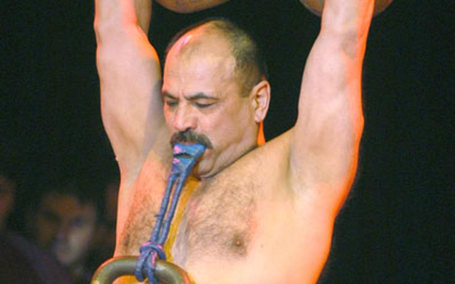 Bakhrom Akhnazarov, or Hercules, lifts weights with his arms and teeth as part of his act with the Moscow State Circus. For his finale, Hercules is run over by a truck.