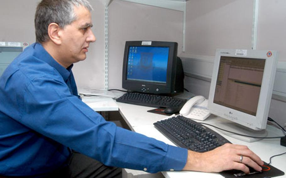 Phil Hammond, an information technology administrator for the 48th Contracting Squadron, checks the database backups. Last month, Hammond received the 2005 USAFE Outstanding Contracting Support award.