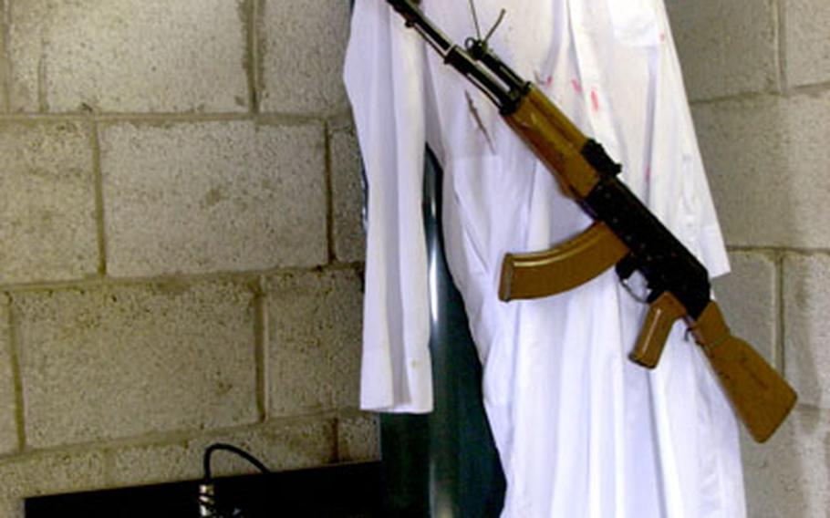 A mannequin's clothing is covered in red marks showing it has been shot with simunitions.