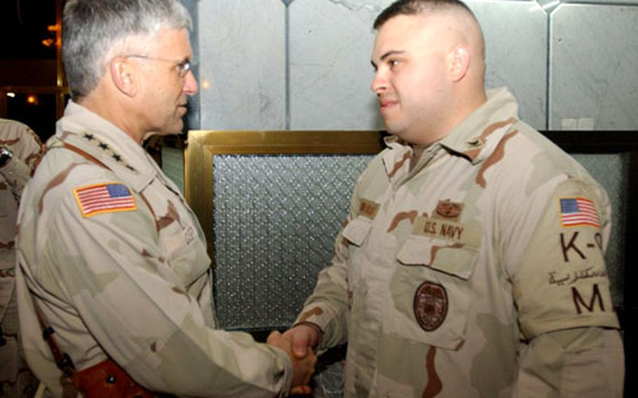Petty Officer 1st Class Anthony Gonzales with Gen. George Casey, the top U.S. military leader in Iraq.