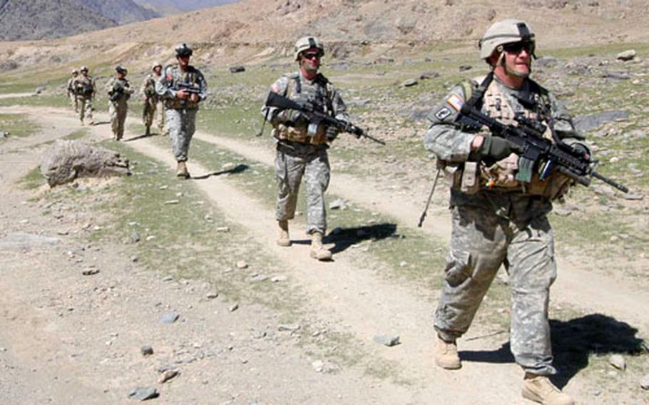 Soldiers of 3rd Platoon, Company B, 2nd Battalion, 503rd Infantry Regiment, 173rd Airborne Brigade and 1st Platoon, Company A, 2nd Brigade, 4th Infantry Regiment, 4th Brigade, 10th Mountain Division patrol near Forward Operating Base Arghandab in Afghanistan.