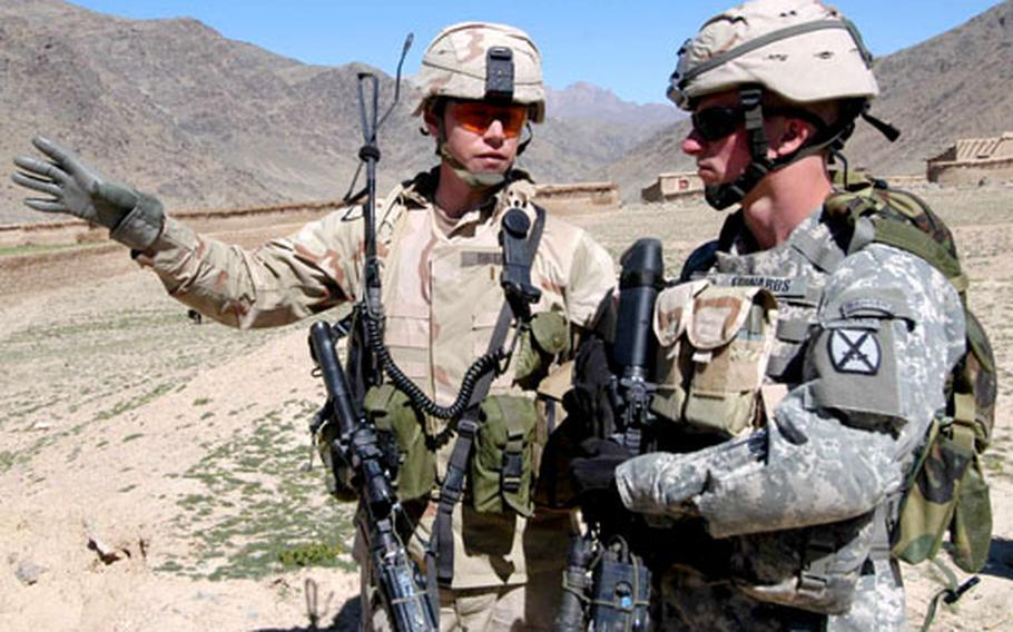 Second Lt. Ian Dietz, left, of 3rd Platoon, Company B, 2nd Battalion, 503rd Infantry Regiment, 173rd Airborne Brigade, talks with 1st Lt. Ryan Edwards, 1st Platoon, Company A, 2nd Brigade, 4th Infantry Regiment, 4th Brigade, 10th Mountain Division on an orientation tour of the villages near Forward Operating Base Arghandab in Afghanistan.
