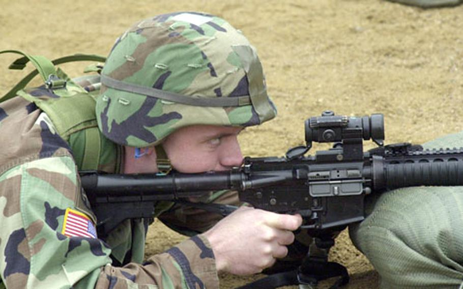 Capt. Henry Moltz lines up a shot with his M-4 rifle during range qualifications at Camp Bonifas, a minute or two away from the Demilitarized Zone.