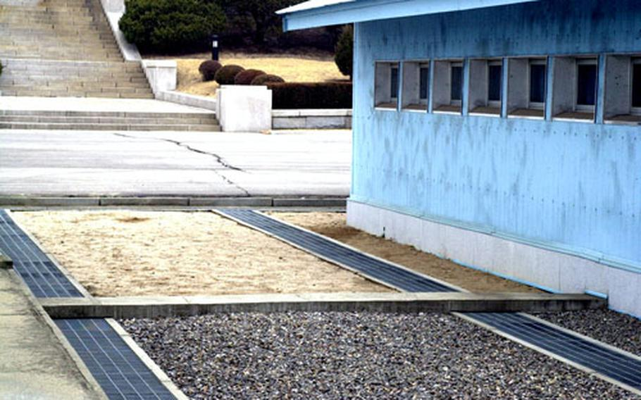 The concrete line in the center is all that separates South and Korea at the United Nations-administered Joint Security area.