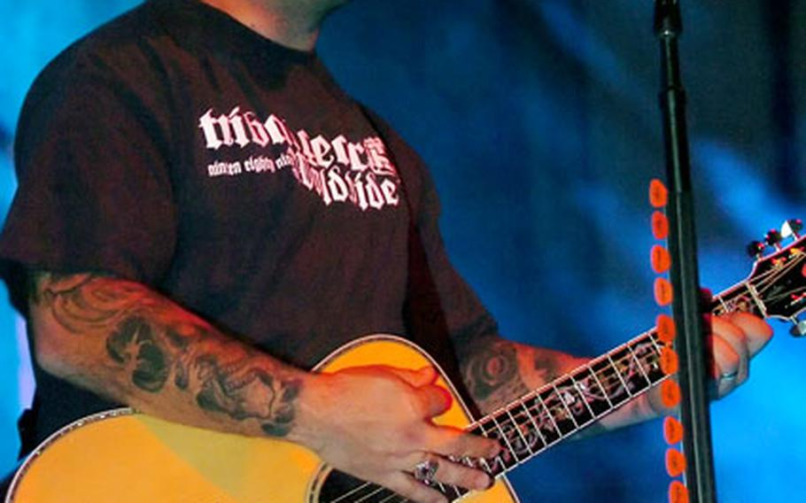 Staind's Aaron Lewis performs for U.S. troops in Baumholder, Germany, Friday night.