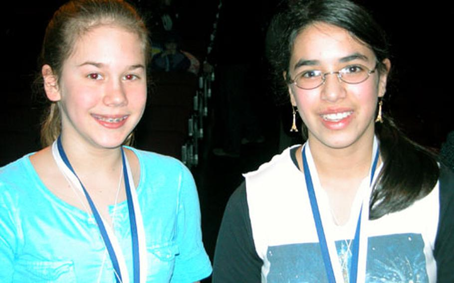 """After outlasting 34 other contestants and going toe-to-toe for four rounds, Amanda Suarez, right, spelled """"salivate"""" and beat her closest competition, Caroline Hicks, left, during the 24th annual European Spelling Bee Saturday in Kaiserslautern."""