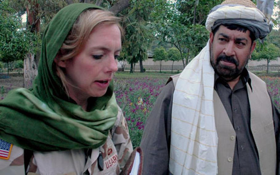 Lt. Col. Linda Granfield discusses upcoming projects and politics with Nangarhar Gov. Gul Agha Sherzai. The Jalalabad Provincial Reconstruction Team has formed a tight bond with local leaders.