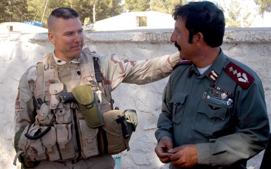 Lt. Col. Mark Stammer, 2nd Battalion, 503rd Infantry Regiment commander, left, and Aaka Jan Rasool, police chief of Tran Wajaldak district, at their last meeting at the chief's headquarters in Shahr-E Safa, Afghanistan.