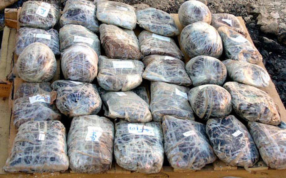 A pallet with 43 kilograms of confiscated heroin base before it was destroyed at Forward Operating Base Lagman.