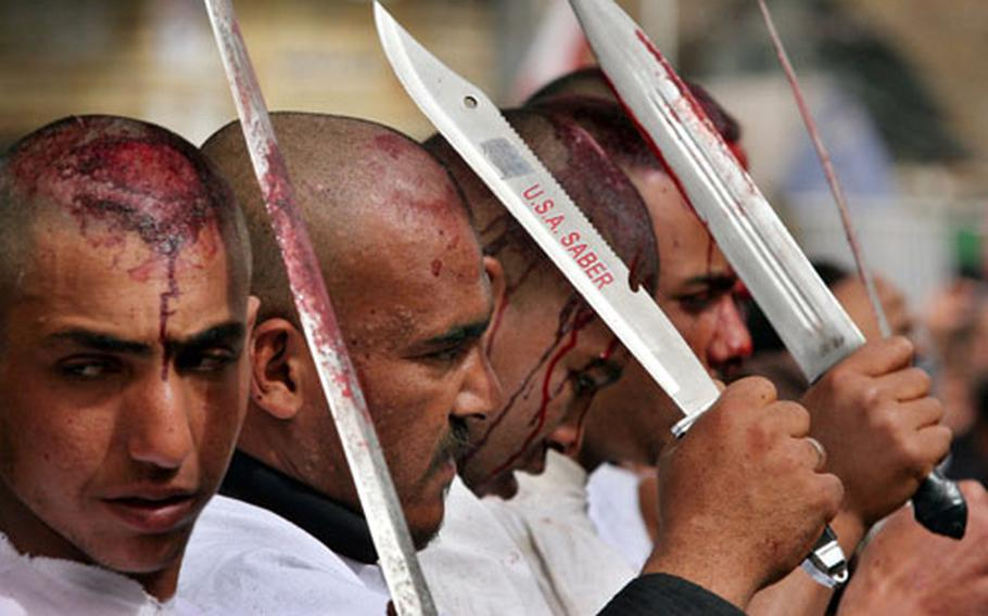 Iraqi Shiite Muslims flagellate themselves during a procession in Karbala on Monday. A million Shiite Muslim pilgrims descended on the holy city of Karbala to mark the 40th and final day of mourning for Imam Hussein, the Prophet Muhammad's grandson, who died in Karbala in 680.