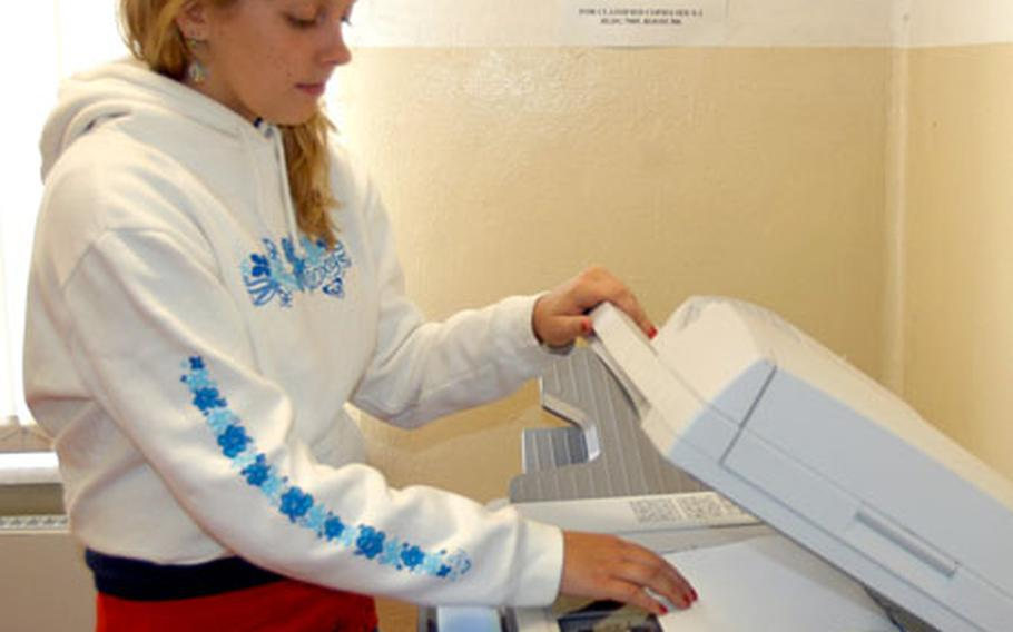 Ashlee Kozel, 15, makes copies as part of her job as a Morale, Welfare and Recreation marketing assistant through the Summer Hire program in Bamberg, Germany, in 2005.