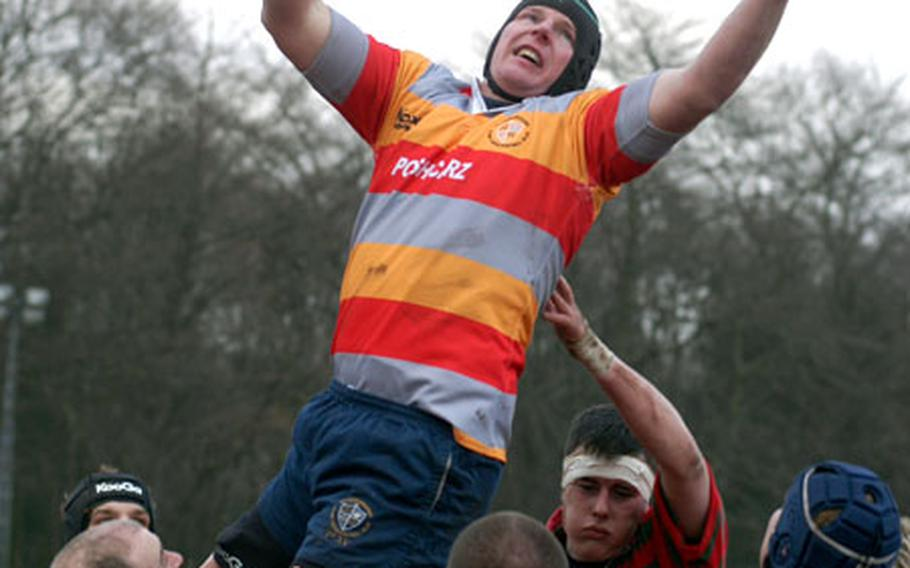 During a lineout play, Staff Sgt. Alf Thompson is lifted up into the air to catch a throw from out of bounds.