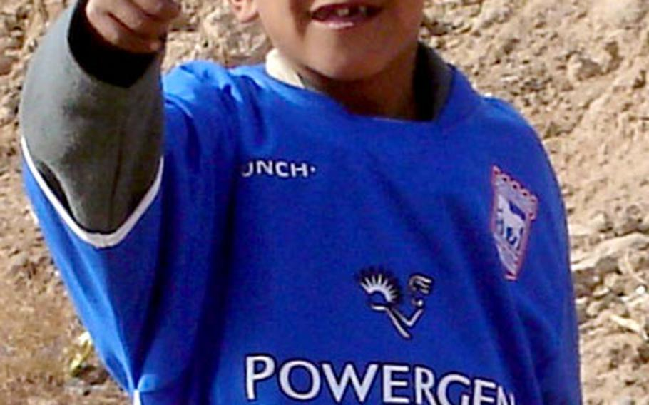 An appreciative Iraqi child in Diyala province gives his approval after receiving a soccer jersey.