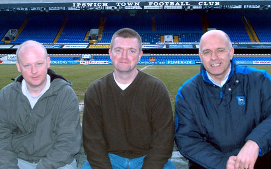 Ipswich Town Football Club fan newsletter editor Phil Ham, U.S. Army Captain Mark Stoneman and Ipswich Town Football Club communications director Terry Baxter, left to right, at the team's stadium in downtown Ipswich. The three took part in the campaign to send soccer uniforms to children in Iraq.