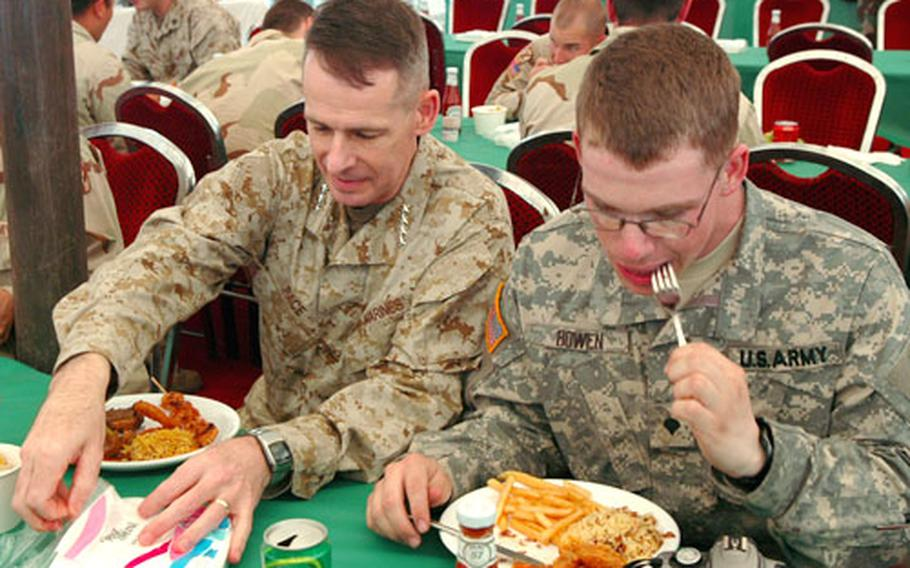 During a stop at Muzaffarabad, Pakistan, Chairman of the Joint Chiefs of Staff Gen. Peter Pace, left, had lunch with soldiers from the 10th Mountain Division of Fort Drum, N.Y.