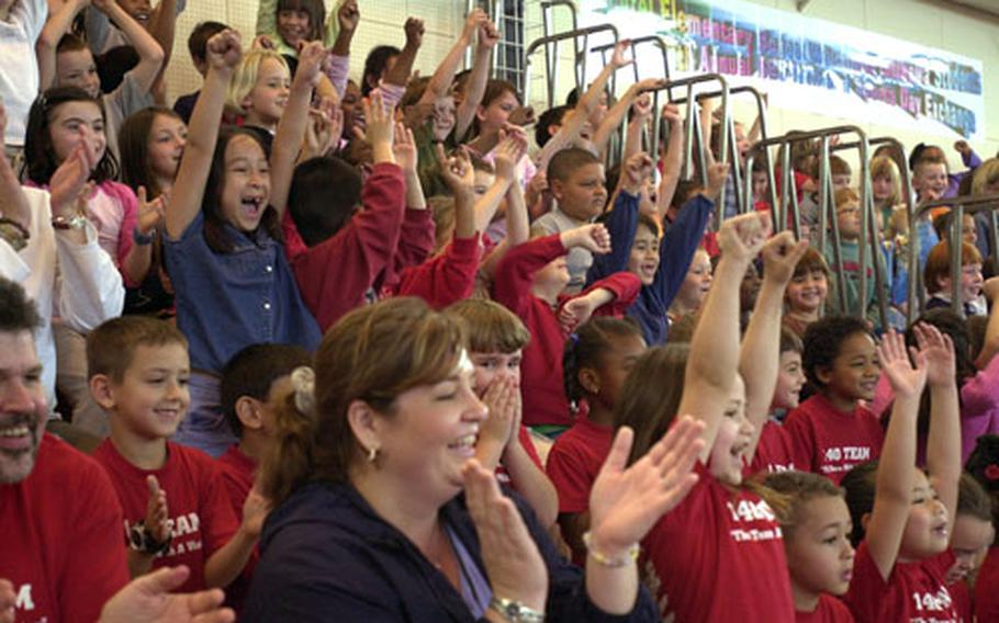 Students at Bechtel Elementary School celebrate after a fellow student defeated a Chubu Norin High School sumo wrestler during the Ryukyu Festival.