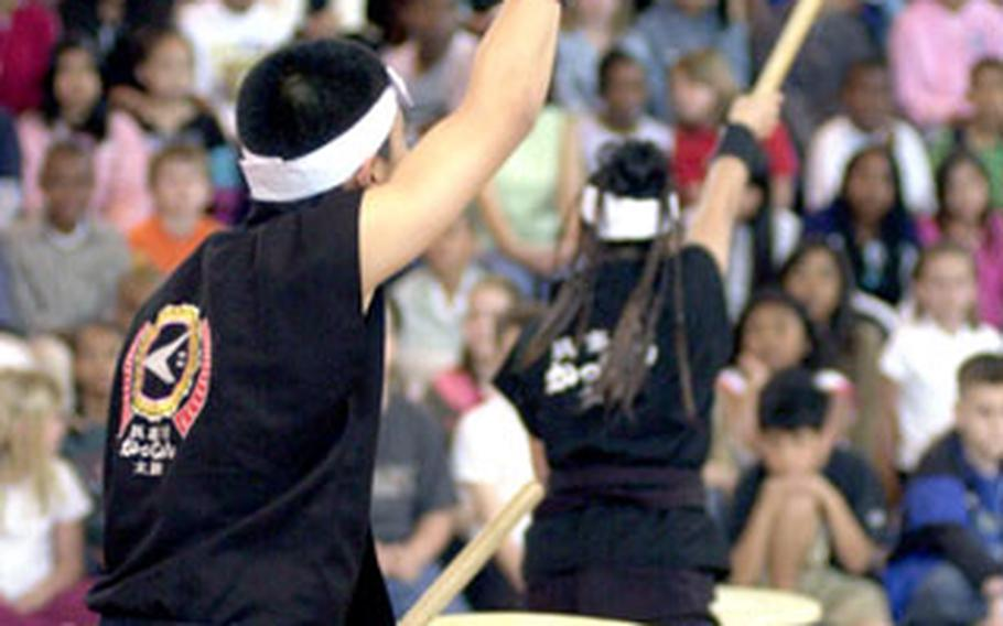 Members of the Gushikawa Kasshin Taiko Drummers perform at the Ryukyu Festival.